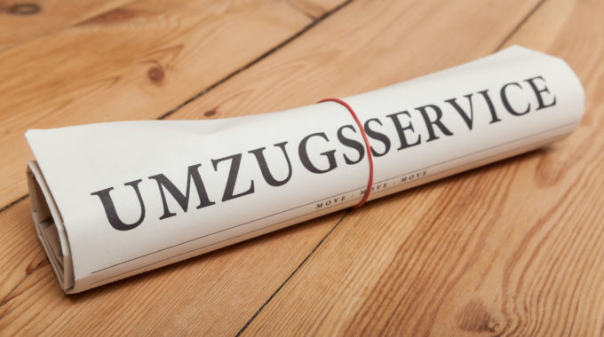 "26819193 - ""umzugsservice"" German Newspaper On Wooden Floor"
